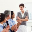 A diverse business group applauding a good presentation - Foto Stock