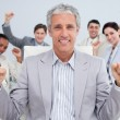 Happy businessman celebrating a sucess with his team — Stock Photo #10290672