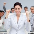 Stock Photo: Happy business celebrating sucess with hands up