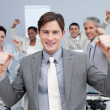 Happy business team celebrating a sucess with hands up — Stock Photo #10290678