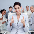 Happy business team with thumbs up — Stockfoto