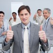 attractive businessman celebrating a sucess with his team — Stock Photo