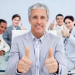 Mature manager celebrating a sucess with his team - Stock Photo