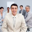 Young businessman smiling in a meeting - Stock Photo