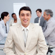 Confident businessman smiling in a meeting — Stock Photo