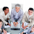Foto Stock: High angle of multi-ethnic business team in meeting
