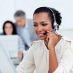 Confident businesswoman talking on headset — Stock Photo