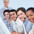 Cheerful business partners working in a call center — Stock Photo