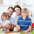 Happy family preparing dinner together — Stock Photo #10290933