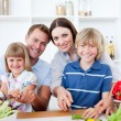 Happy family preparing dinner together - Stock Photo