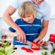 Jolly father and his son cooking - Stock Photo