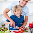 Cheerful father and his son cooking — Stock Photo #10290937