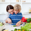 Happy mother and her son cooking — Stock Photo