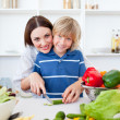 Stock Photo: Caring mother and her son cooking