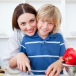 Royalty-Free Stock Photo: Attractive mother and her son cooking