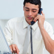 Concentrated Hispanic businessman on phone — Stock Photo