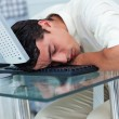 Tired businessman sleeping at his desk - Stock Photo