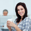 Glowing businesswoman drinking a coffee — Stock Photo