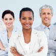 Diverse business standing with folded arms - Stock Photo