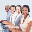Stock Photo: Multi-ethnic customer service representatives using headset