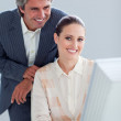 Portrait of a businesswoman and her manager working at a compute — Stock Photo