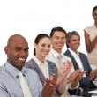 Stock Photo: Multi-ethnic business applauding after a presentation