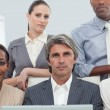 Cocentrated diverse business working at a laptop — Stock Photo