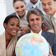 International business group smiling at global business expansio — Stock Photo