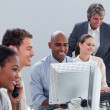 Confident business team at work - Stock Photo