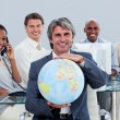 Foto Stock: Fortunate business team at work showing a terrestrial globe