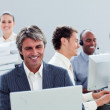 Portrait of a smiling business team at work — Stock Photo