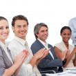 Assertive business clapping a good presentation — ストック写真