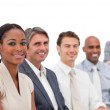 Positive business team smiling at the camera — Stock Photo