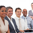 Multi-ethnic business team smiling at the camera — Stockfoto