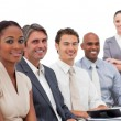 Multi-ethnic business team smiling at the camera — Foto de Stock