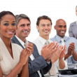 Positive business team applauding a good presentation — ストック写真