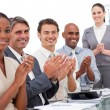 Happy business team applauding a good presentation — Stock Photo #10291864