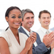 Stock Photo: International business applauding presentation