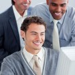 Royalty-Free Stock Photo: Smiling businessmen working at a computer