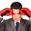 Stressed businessman with boxing gloves — Stock Photo #10292042