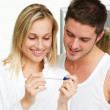 Womand mexamining pregnancy test — Stock Photo #10292077