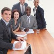 Five business in a meeting smiling at the camera — Stock Photo