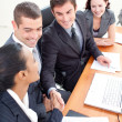 Business team in a meeting shaking hands — Stok fotoğraf