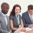 Photo: Smiling businesswoman working in a meeting