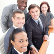 Smiling business team in a meeting shaking hands — Stockfoto