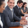 Smiling attractive businessman in a meeting — Stock Photo #10292116