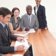Businessteam working together in a meeting — Stock Photo