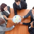 High Angle of businessteam holding a globe and businessman smili — Foto de Stock