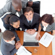 Stock Photo: Businessteam working with their boss with a laptop