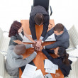 Photo: High angle of business team with hands together